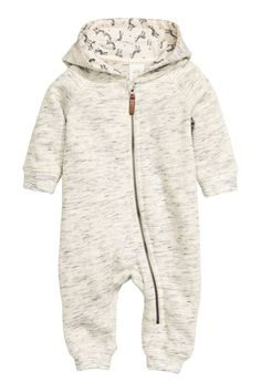 Natural white melange. CONSCIOUS. Jumpsuit in sweatshirt fabric. Jersey-lined hood, zip at front and along one leg, and ribbing at cuffs and hems. Soft,