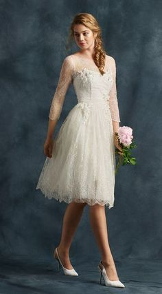 Classy knee length quarter sleeve wedding dress with pretty lace; Featured Dress: Atelier Eme 2017