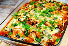 Checkout this Chicken Enchilada Casserole Recipe at LaaLoosh.com! All the deliciousness of chicken enchiladas, but in an easier to prepare casserole form.