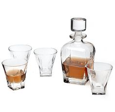 Godinger Silver Art Madison Avenue Crystal 5 Whiskey Decanter Set Glasses --------------------------------------------------------------------------------------------- This set includes four double old fashioned scotch glasses and one whiskey decanter. Its made from quality crystal material that is appealing due to its shine and makes a  great gift for any occasion.