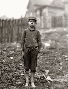 "April 1913. Rome, Georgia. Neil Power, 10 years old. Said ""turns stockings in Rome Hosiery Mill."" A shy, pathetic figure. ""Hain't been to school much."" Photo and caption by Lewis Wickes Hine."