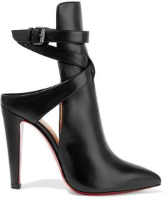 Christian Louboutin's 'Pointipik' pumps are a chic cross between a mule and an ankle boot. Crafted from smooth black leather, this architectural pair has an elegant pointed toe and crossover ankle strap for added support. Make sure the signature red lacquered sole is visible with cropped or midi hemlines.