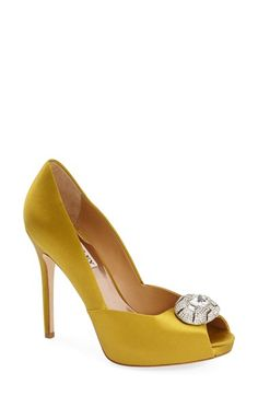 Free shipping and returns on Badgley Mischka 'Pearla' Pump (Women) at Nordstrom.com. A huge, sparkling crystal medallion tops a deliciously curvy peep-toe pump available in lustrous berry-hued satin or shimmering silver leather.