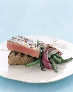 Grilled Tuna Steaks with Japanese Marinade - Martha Stewart Recipes. I used this one on fresh tuna and mahi mahi that my son caught today. Was delicious! Fresh Tuna Recipes, Tuna Steak Recipes, Salmon Recipes, Grilling Recipes, Cooking Recipes, Sushi Recipes, Asian Recipes, Easy Recipes, Oriental Recipes