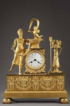 A Restoration gilt bronze mantel clock depicting a young woman wearing a classic tunic and a crown of roses, the face slightly turned to the left, holding in her hands...