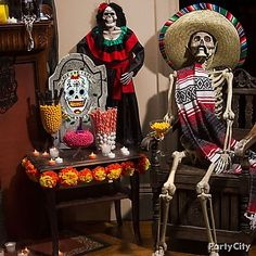 Skeletal sweethearts are the (after)life of the party! Dress-up a skeleton prop with a sombrero, serape & mustache. Then, pair him with his dearly departed hanging señorita!