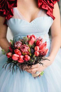 protea and tulips. Bouquet by Fleurology.