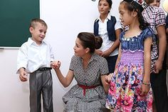 Lola Karimova at the orphanage with children