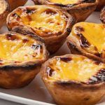 Portuguese custard tarts are well known around the world for their crispy pastry and heavenly delicious filling. Info Preparation time: 15 min Cooking Time: 40 min Ready In: 55 min Level of Difficulty: Easy Servings: 8 Portuguese Custard Tart Recipe, Portuguese Tarts, Portuguese Recipes, Portuguese Food, Portuguese Desserts, Portugese Custard Tarts, Portuguese Culture, Tart Recipes, Cooking Recipes