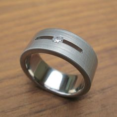 Titanium Floating Diamond Wedding Ring by spexton on Etsy