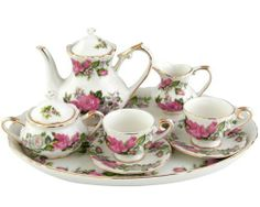 """Grace Tea Ware Miniature Porcelain Pink Rose 10 pc Teaset by Grace Tea Ware. $32.00. Porcelain miniature teaset that measures:3 3/4""""H x 9""""W x 7""""D     Includes 1-Teapot and 1 Tray     2 Teacups & Saucers     1 Creamer & Sugar Bowl and 1 tray     FDA approved/Hand washing recommended"""