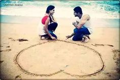 Making heart on sand