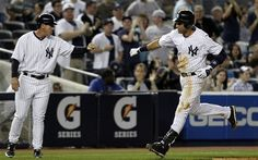 Sunday, April 15, 2012 - New York Yankees' Derek Jeter rounds the bases before bumping fists with Yankees third base coach Rob Thomson after hitting a fourth-inning, three-run home run against the Los Angeles Angels during their baseball game at Yankee Stadium in New York. (AP Photo/Kathy Willens)