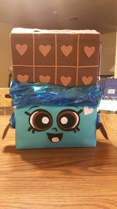 Shopkins Valentine Box. Everything made from felt material, and used blue gift wrap as the wrapper.