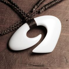 Wave bone carving with braided cord by Studio Tapu