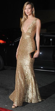 Meanwhile, Karlie Kloss glittered at the L'Oreal Paris Women of Worth Celebration, lighting up the red carpet in a gold sequined deep-V Michael Kors Collection gown, complete with a gold Judith Leiber Couture clutch and Eva Fehren jewelry.