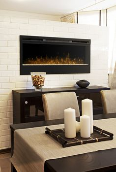 The Dimplex Synergy Electric Fireplace offers patented flame technology, a glass flame bed and multi-function remote control. We are a leading supplier of Dimplex Electric Fireplaces and Electric Fireboxes. Wall Mounted Fireplace, Dining Room Fireplace, Wall Mount Electric Fireplace, Dining Room Walls, Fireplace Design, Fireplace Ideas, Wall Fireplaces, Floating Fireplace, Foyer Mural