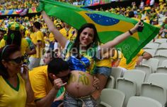 BRAZIL, Fortaleza : A Brazilian pregnant supporter cheers prior to a Group A football match between Brazil and Mexico at the Castelao Stadium in Fortaleza during the 2014 FIFA World Cup on June 17, 2014. AFP PHOTO / YURI CORTEZ