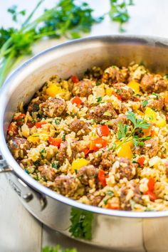 Easy One-Skillet Sausage and Peppers with Rice - Juicy sausage, crisp peppers, onions, and rice all cook together in one skillet! Makes cleanup a breeze! Packed with flavor and ready in 30 minutes! Italian Sausage Recipes, Sweet Italian Sausage, Sausage And Peppers, Stuffed Peppers, Sausage Rice, Hot Sausage, Red Peppers, Rice Recipes, Cooking Recipes