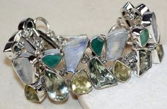 Moonstone,	Citrine Faceted,	Emerald	Green Amethyst, bracelet designed and created by Sizzling Silver. Please visit  www.sizzlingsilver.com. Product code: BR- 8990