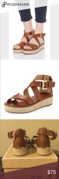 Michael Kors Darby Sandals- Cognac Luggage-colored Michael Kors Darby Sandals. These sandals are brand new, never been worn and are still in the original box. These shoes are super cute and super stylish and can be worn by either adults or tween girls. Will go great with school uniforms, a casual outfit, or a nice sundress. Great shoes at, a great price for someone getting ready to return to school or college. Michael Kors Shoes Sandals