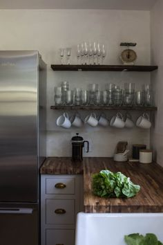 Great open #shelving system above #inset #kitchen cabinetry.    |  DesignSponge.com