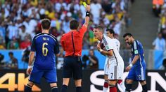 RIO DE JANEIRO, BRAZIL - JULY 13: Bastian Schweinsteiger of Germany is shown a yellow card by referee Nicola Rizzoli during the 2014 FIFA World Cup Brazil Final match between Germany and Argentina at Maracana on July 13, 2014 in Rio de Janeiro, Brazil. (Photo by Matthias Hangst/Getty Images