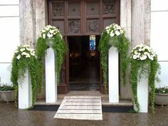 Elegant pillars for any wedding entrance or wedding set.  Can do greenery or flowers or both.  www.CreationsbyDebbie.net
