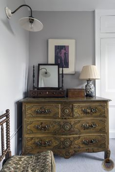 'Corner detail of a beautiful feminine bedroom we worked on in a London home, the Donald Kaufman light grey walls are the perfect backdop to the bohemian clients amazing pop art collection.' Rachel Chudley