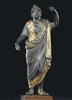 A ROMAN PARCEL GILT SILVER SERAPIS CIRCA 1ST CENTURY A.D.