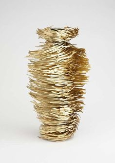 Hirsutio vase by Giles Miller Hirsutio vase  can be manipulated to form whatever profile the user desires. Inspired by style reminiscent of traditional ceramic pot production, the brass 'hairs' are brushed around to form the shape.