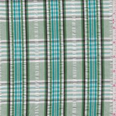 Spring green, pale green, turquoise, white and black plaid. This lightweight cotton fabric has a silver accent pinstripe. (1940s sundress.)