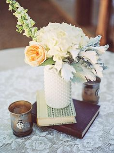 white vase and antique book centerpiece Fulford Barn Brownfield, Texas