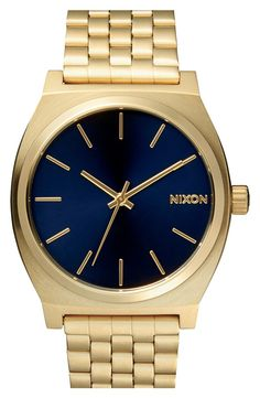 This gold and blue Nixon watch will make the perfect gift for him this season.