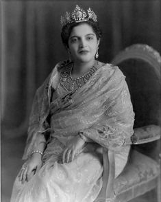 Portrait of Princess Rafat Zamani Begum, c. 1960. Portrait of Princess Rafat Zamani Begum of Rampur (1907-1987), wife of Nawab Raza Ali Khan, taken by the famous Kinsey Brothers studio of Delhi. She wears an embroidered sari with a diamond tiara and ornate neckpiece, in European fashion. The begum traveled to Europe in the 1930s and returned with a modern outlook, including her rejection of purdah.