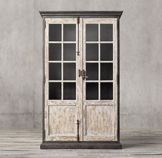 RH's Toulon Balcony Glass Door Cabinet:Modeled after a pair of distressed vintage balcony doors that once graced a home in the south of France, our cabinet's wood doors are set within a sturdy steel frame – mixing Old World character with an industrial sensibility.