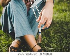 Image result for people holding wooden Buddhist Mala necklace