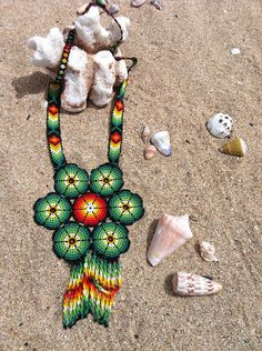 huichol beaded cross | The flower of peyote meands protection.