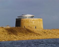 "INDUSTRIAL DESIGNER DUNCAN JACKSON × PIERCY & CO ARCHITECT  Renovates Old Tower Military British 1800 ""Martello Tower Y"" In To Family  Home, a massive Napoleonic-era circular fortification situated on the cost of Suffolk. England began building these Martello towers all along their coast in"