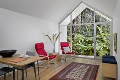 Converted Garage - Red POÄNG chairs from IKEA in Berkeley cottage by Turnbull Griffin Haesloop.