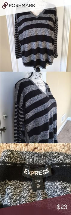 EXPRESS Striped Sweater! 🖤 This stunning sweater from EXPRESS features black and grey stripes. The sweater is gathered slightly on the sides and the size is XS, but runs a little bigger and I would say is more a size S/M.  Feel free to make an offer or bundle for a discount! ❤️ Express Sweaters V-Necks
