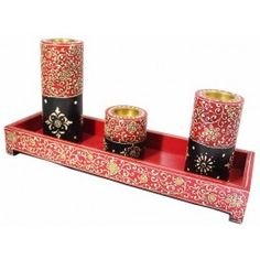 Looking for a truly distinctive candleholder? Using traditional deep red, black and white accents that create an amazing contrast, the candleholders rely on a tall and solid form. With varying heights, the candleholders will allow you to create a tremendous amount of ambient light, or condense the light by gathering them together. Either way, they will easily hold their own with or without any candles thanks to their distinctive beauty and remarkable artisan quality.