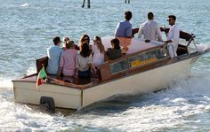 Setting off: Kate, daughter Lila Grace and Princesses Beatrice and Eugenie enjoy a boat ride in the floating city before heading off for dinner with Sarah Ferguson and David Tang  Read more: http://www.dailymail.co.uk/tvshowbiz/article-2383762/Kate-Moss-enjoys-Venetian-dinner-date-close-friends-David-Tang-Sarah-Ferguson-Princesses-Beatrice-Eugenie.html#ixzz2auyep5MJ  Follow us: @MailOnline on Twitter | DailyMail on Facebook