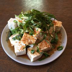 Warm weather calls for chilled tofu (medium-firm is ). Here with green o's, ichimi togarashi pepper, homegrown shiso, and sashimi-grade soy sauce.  Light, easy and delicious.