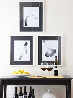 Create an artsy display in your kitchen and adjacent rooms with your own photos of culinary tools shot on a crisp white backdrop. Place the prints in white frames with black mats -- both easily found on sale at crafts stores.
