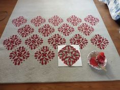 grab an old rug and some fabric paint and make over a rug for very little cost. the end result looks amazing
