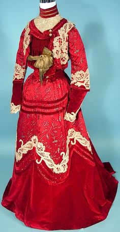 Stunning red late Victorian ensemble. 1890s somewhere? Beautiful lace appliqués. Shirtwaist fashions.