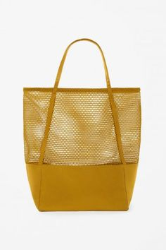 This large bag is made from contrasting mesh and canvas panels. A shopper style, it has long canvas handles and a single interior compartment. Sacs Design, Clutch Bag, Tote Bag, Clear Bags, Nylon Bag, Shopper Bag, Kids Bags, Fashion Bags, Couture