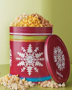 Reuse empty Christmas popcorn tins to store ornaments, lights, bows ... stack them for easy storage.