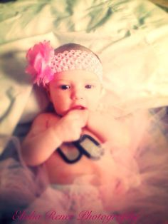 Emma Leigh.. Love this picture of her with her daddy's dog tags. Pretty in pink